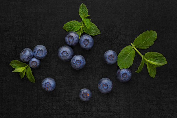 Blueberries isolated on black background. stock photo
