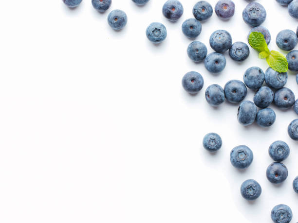 blueberries isolated on white background - blueberry stock pictures, royalty-free photos & images