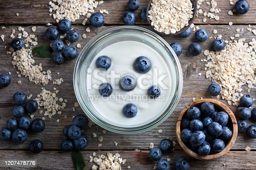Blueberries, oat flakes and yoghurt - top view