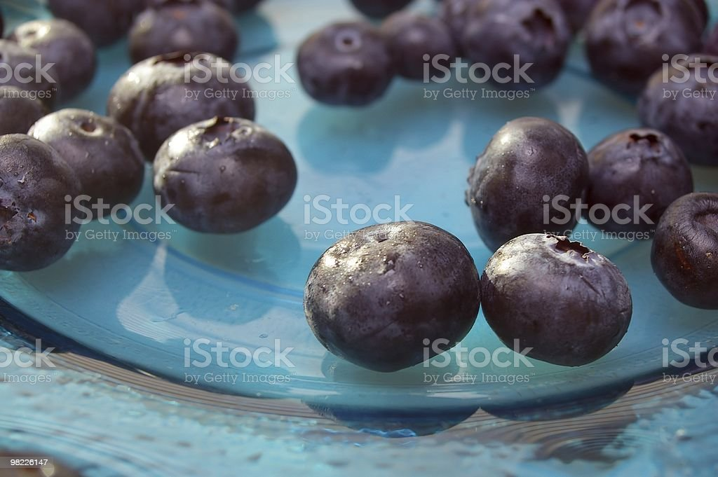 blueberries of blue glass plate royalty-free stock photo