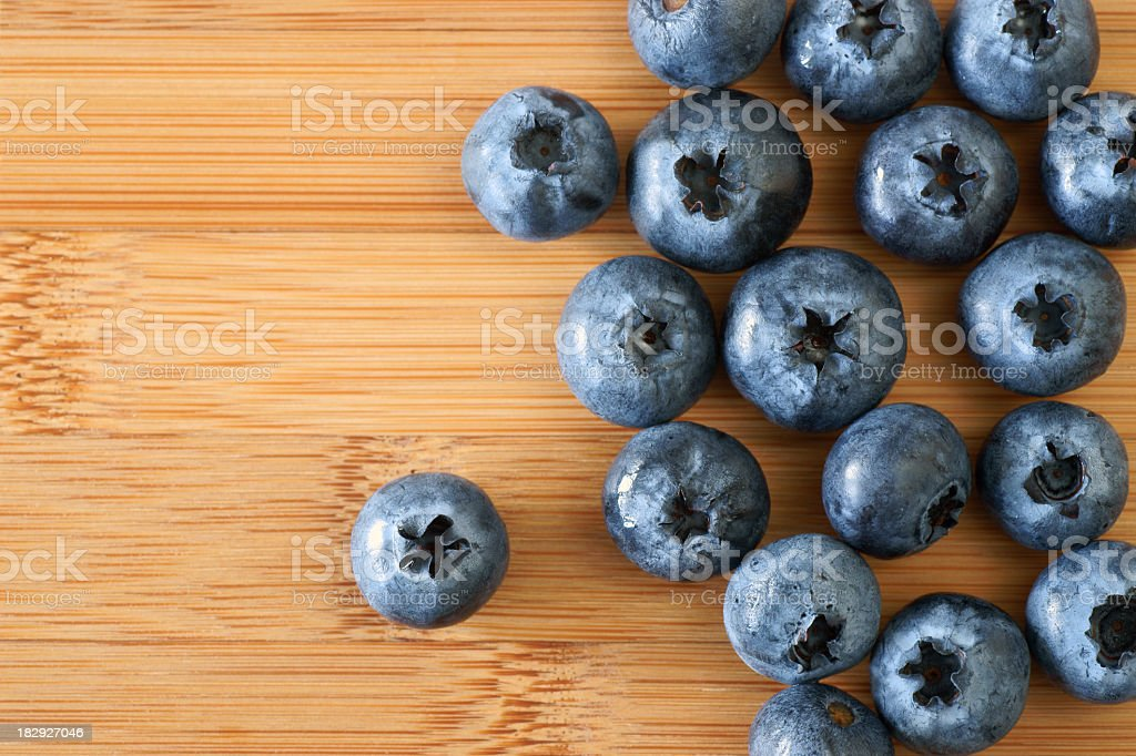 Blueberries on a bamboo background. royalty-free stock photo
