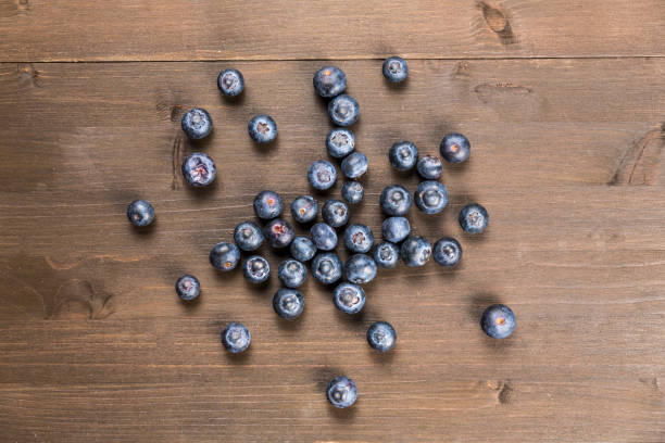Blueberries on a wooden background stock photo