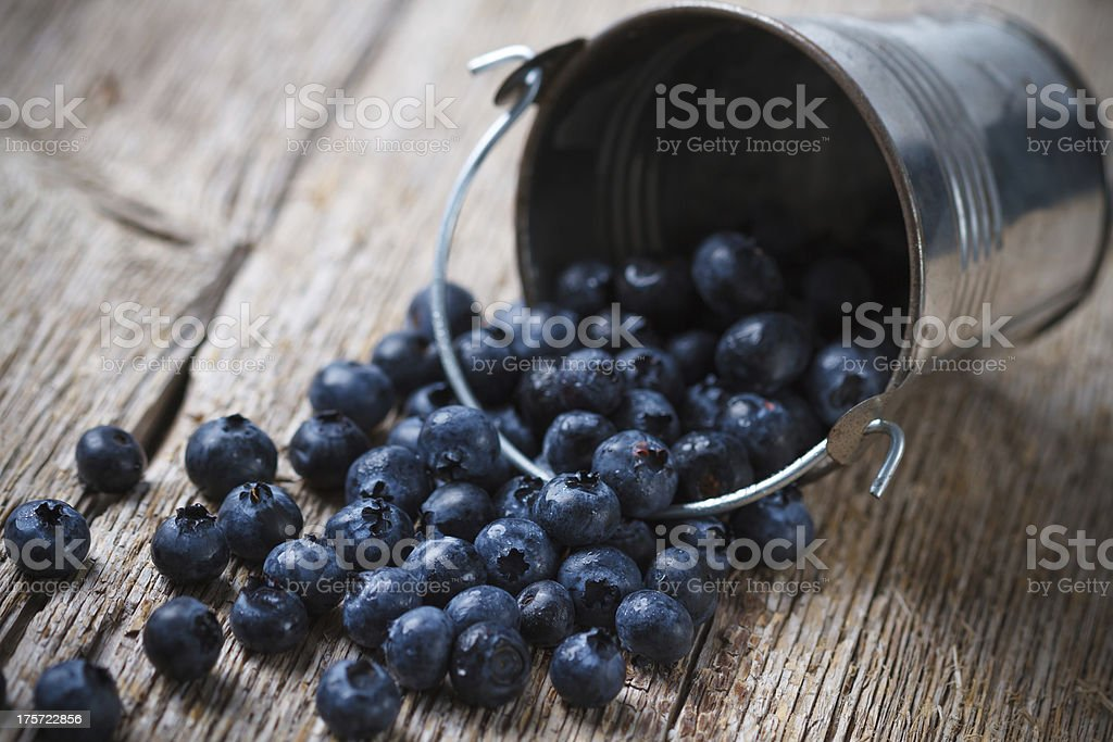 Blueberries on wooden background royalty-free stock photo