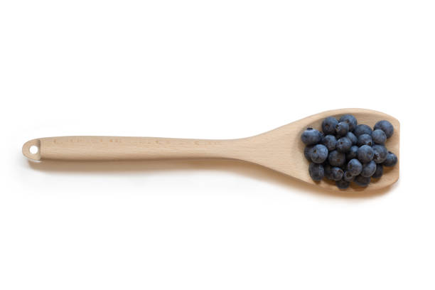 Blueberries on Wooden Spoon stock photo