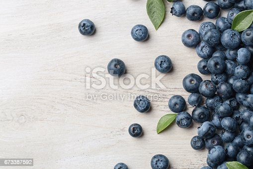 istock Blueberries on wooden table 673387592