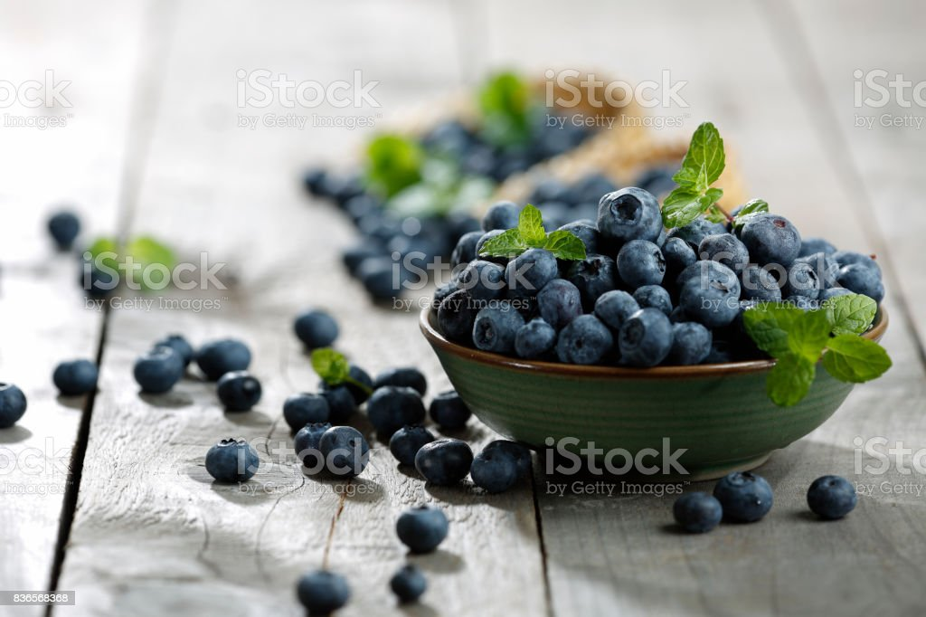 Blueberries on wooden table stock photo