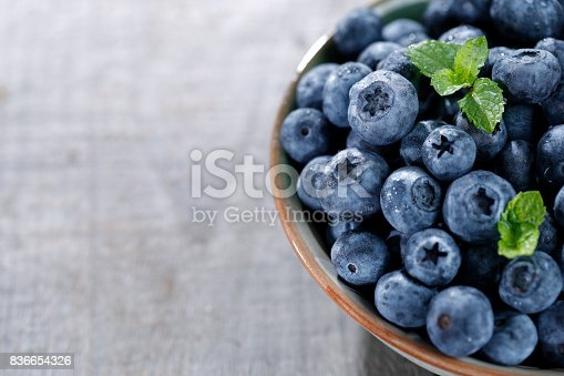 istock Blueberries on wooden table 836654326