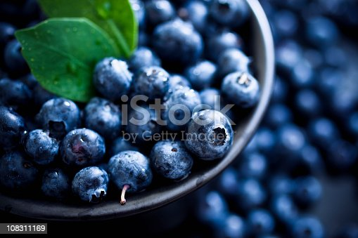 Blueberries with leaves. Selective focus