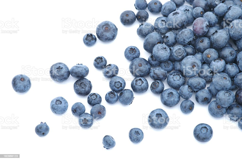 Blueberries scattered on white background stock photo