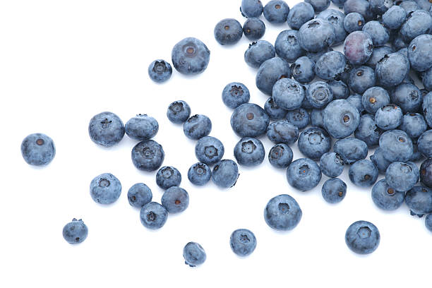 blueberries scattered on white background - blueberry stock pictures, royalty-free photos & images