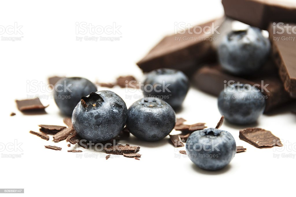 Blueberries with chocolate isolated on white background stock photo