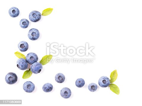 828761410 istock photo Blueberries with leaves isolated on white background, top view 1171080669