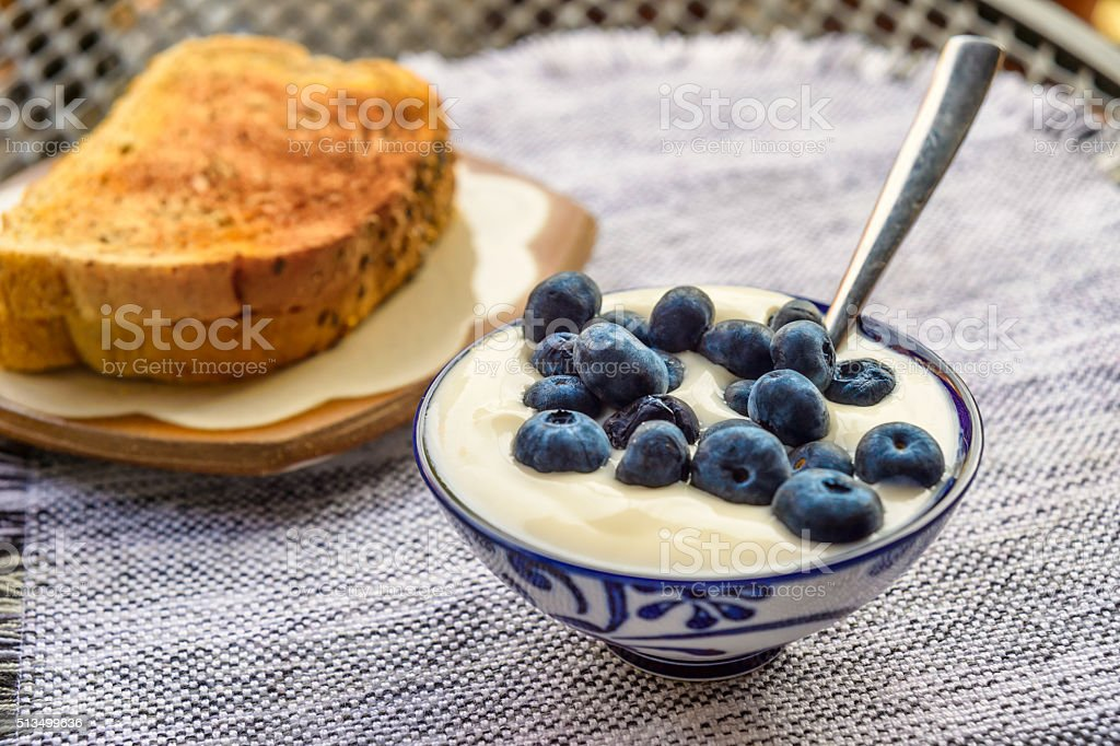 Blueberries with yoghourt and toasts stock photo