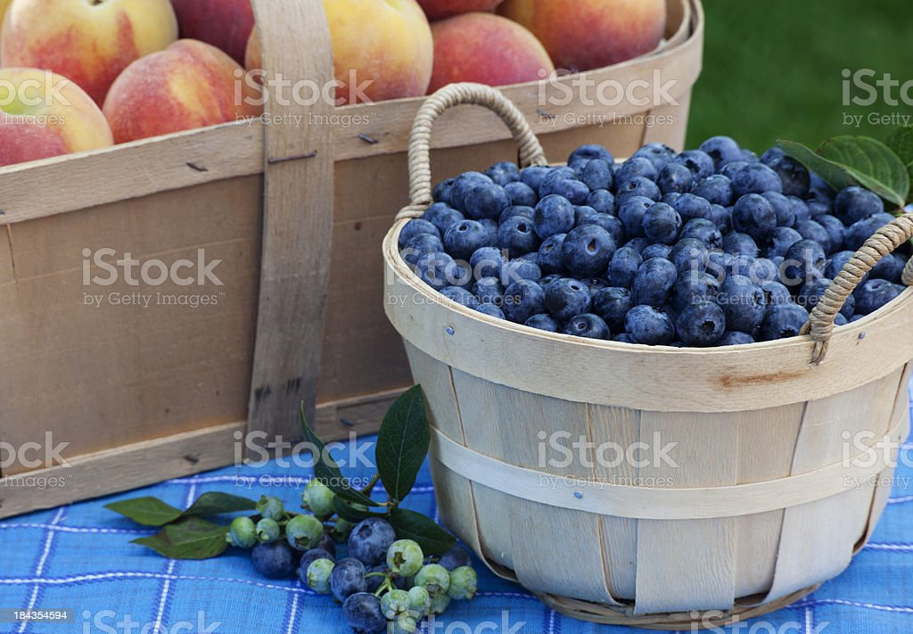 Blueberry and Peach Baskets stock photo