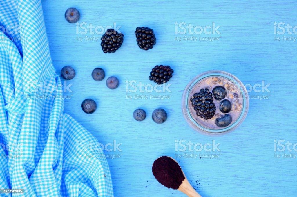 Blueberry balckberry chia overnight oats stock photo