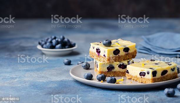 Blueberry bars cake cheesecake on a grey plate picture id619266510?b=1&k=6&m=619266510&s=612x612&h=u9aplzo npd wknuh6b4ha5elwrfwjslctupouxh2mm=