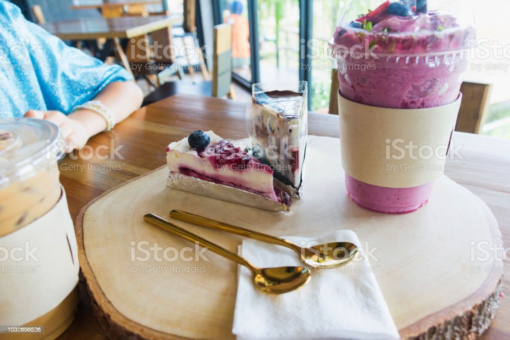 blueberry cake on chopping block in cafe stock photo