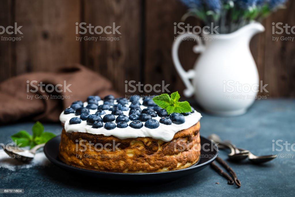 Blueberry cake with fresh berries and whipped cream, cheesecake stock photo