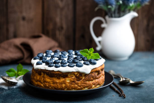 blueberry cake with fresh berries and whipped cream, cheesecake - blueberry pie stock photos and pictures
