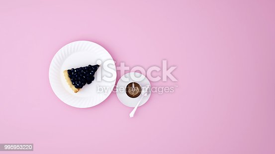 istock Blueberry cheesecake and latte art coffee on pink background - Artwork for coffee break - Launch time in cafe - 3D Rendering 995953220