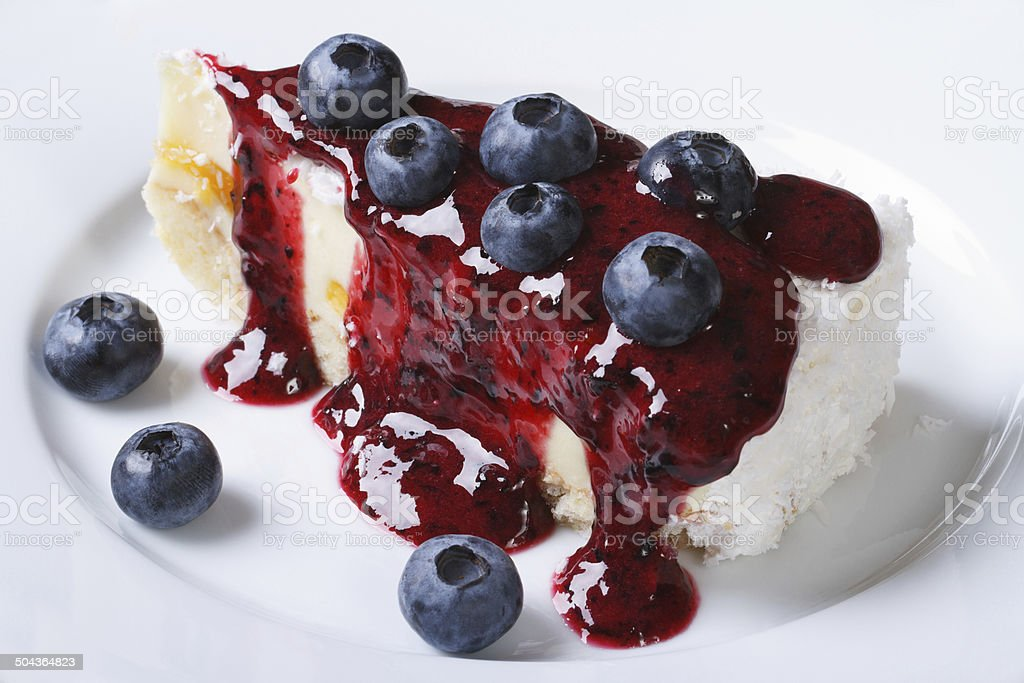 Blueberry cheesecake with berry sauce horizontal top view stock photo