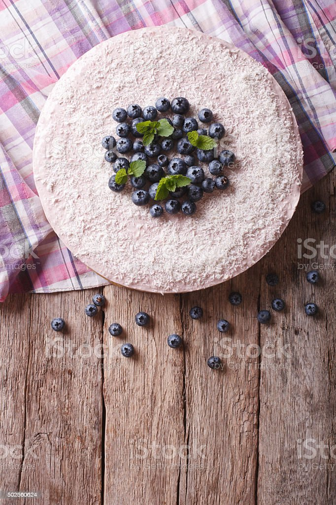 blueberry cheesecake with mint and coconut. vertical top view stock photo
