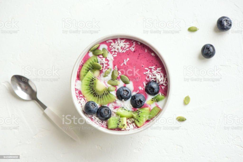 blueberry coconut smoothie bowl stock photo