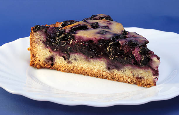 Blueberry Cream Flan on Blue stock photo