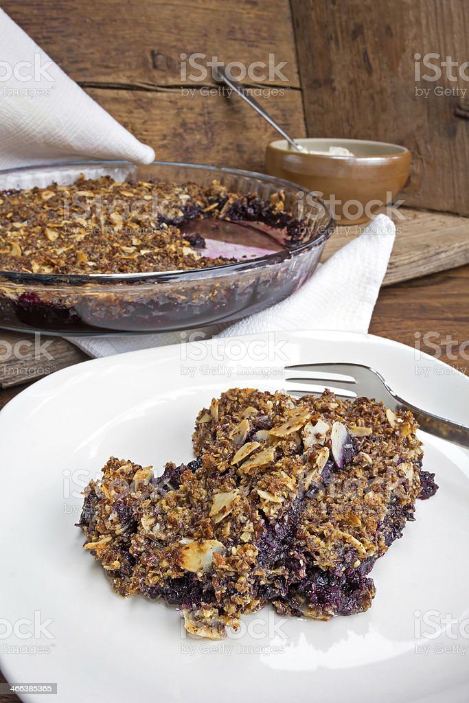 Blueberry crumble in rustic setting stock photo