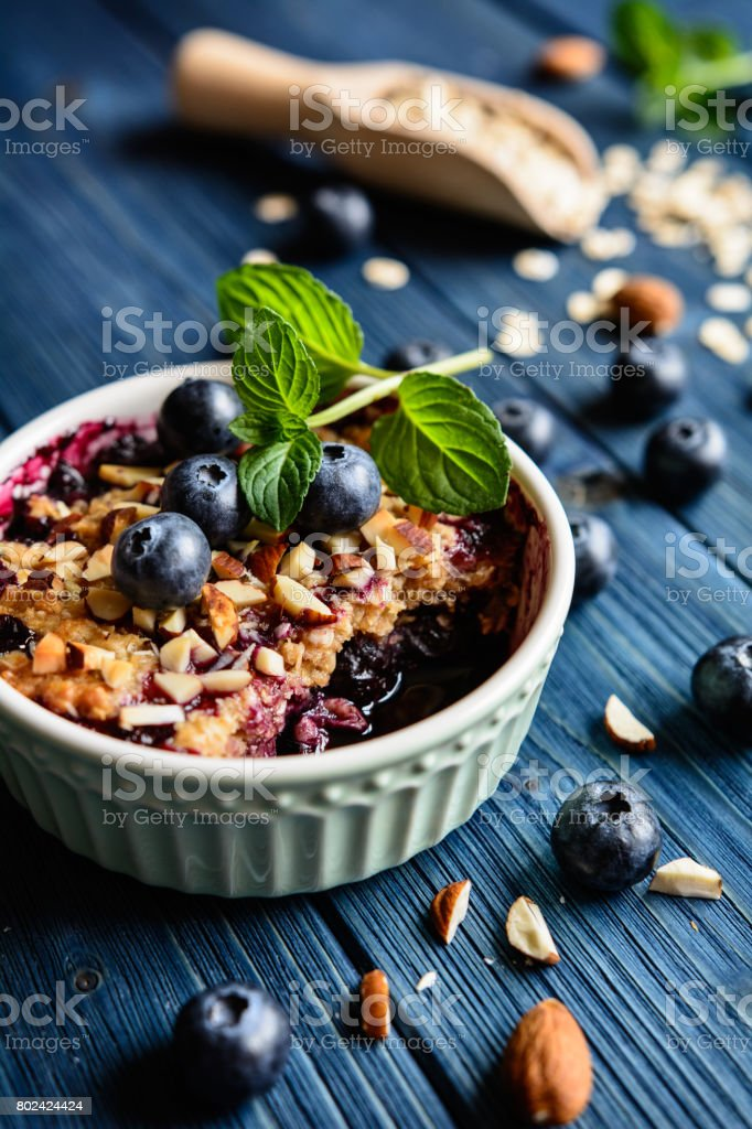 Blueberry crumble with oat flakes and almonds stock photo