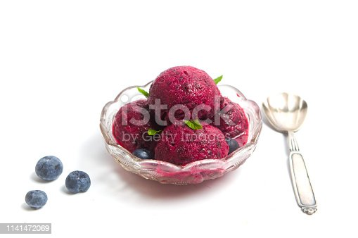 Blueberry fruit ice cream in a cup isolated on white