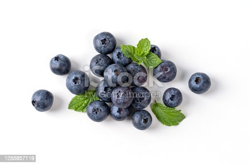 670420880 istock photo Blueberry fruit top view isolated on a white background, flat lay overhead layout with mint leaf, healthy design concept. 1255857119