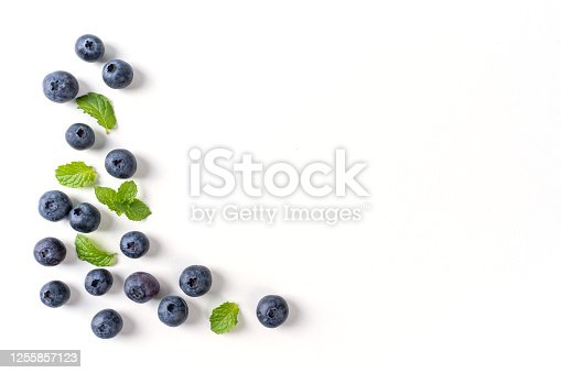 670420880 istock photo Blueberry fruit top view isolated on a white background, flat lay overhead layout with mint leaf, healthy design concept. 1255857123