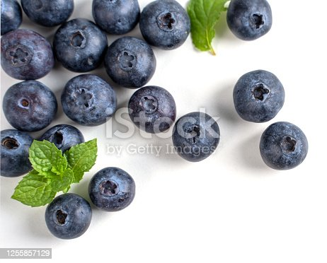670420880 istock photo Blueberry fruit top view isolated on a white background, flat lay overhead layout with mint leaf, healthy design concept. 1255857129