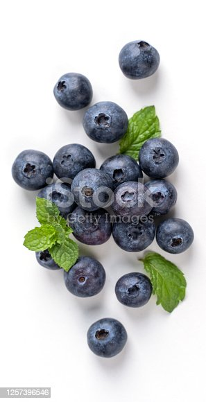 670420880 istock photo Blueberry fruit top view isolated on a white background, flat lay overhead layout with mint leaf. 1257396546