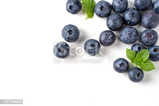 670420880 istock photo Blueberry fruit top view isolated on a white background, flat lay overhead layout with mint leaf. 1257396559