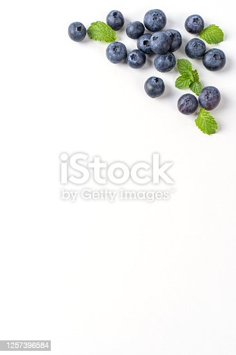 670420880 istock photo Blueberry fruit top view isolated on a white background, flat lay overhead layout with mint leaf. 1257396584