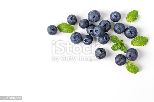 670420880 istock photo Blueberry fruit top view isolated on a white background, flat lay overhead layout with mint leaf. 1257396585