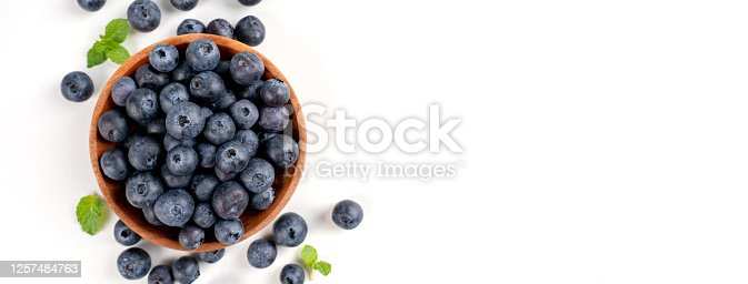 670420880 istock photo Blueberry fruit top view isolated on a white background, flat lay overhead layout with mint leaf, healthy design concept. 1257484763