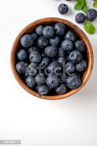 670420880 istock photo Blueberry fruit top view isolated on a white background, flat lay overhead layout with mint leaf, healthy design concept. 1257484771