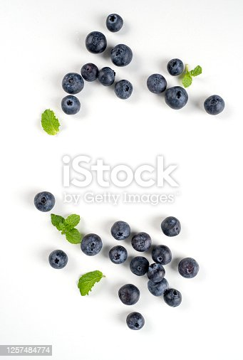 670420880 istock photo Blueberry fruit top view isolated on a white background, flat lay overhead layout with mint leaf, healthy design concept. 1257484774