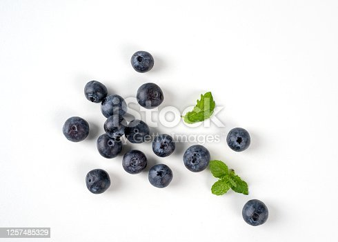 670420880 istock photo Blueberry fruit top view isolated on a white background, flat lay overhead layout with mint leaf, healthy design concept. 1257485329