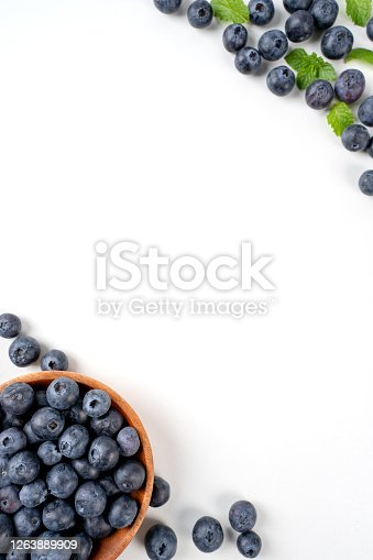 670420880 istock photo Blueberry fruit top view isolated on a white background, flat lay overhead layout with mint leaf, healthy design concept. 1263889909