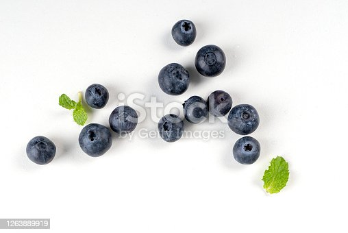 670420880 istock photo Blueberry fruit top view isolated on a white background, flat lay overhead layout with mint leaf, healthy design concept. 1263889919