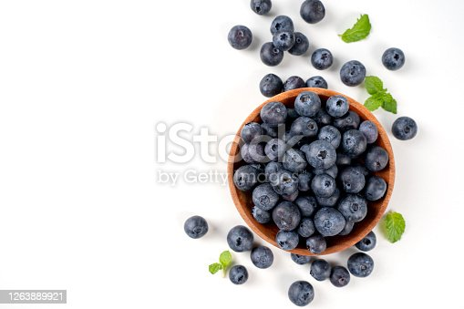 670420880 istock photo Blueberry fruit top view isolated on a white background, flat lay overhead layout with mint leaf, healthy design concept. 1263889921