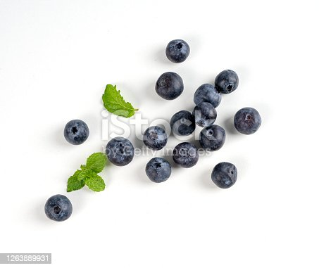 670420880 istock photo Blueberry fruit top view isolated on a white background, flat lay overhead layout with mint leaf, healthy design concept. 1263889931