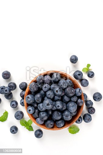 670420880 istock photo Blueberry fruit top view isolated on a white background, flat lay overhead layout with mint leaf, healthy design concept. 1263889938