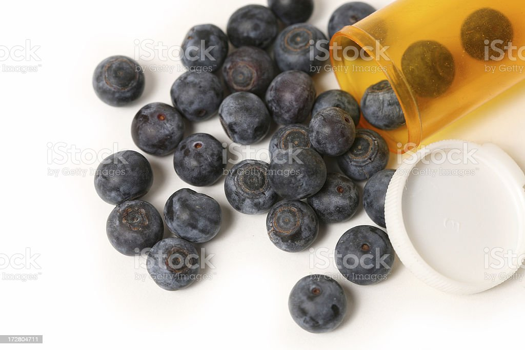 Blueberry in medicine bottle royalty-free stock photo