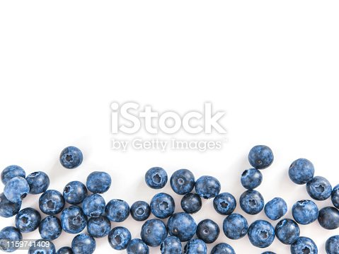 Creative layout with fresh ripe berries. Blueberry isolated on white background with copy space. Can use for your design, promo, social media. Top view.