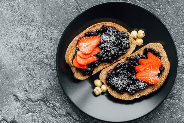 blueberry jam on bread stock photo